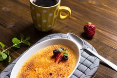 Creme Brulee Dessert with Caramelised Sugar, Strawberry, Blueberry and Fresh Mint Leaves royalty free stock image