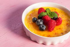 Creme brulee Dessert wih fruits and mint leaves Royalty Free Stock Photography