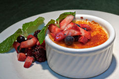 Creme Brulee with fresh fruit and mint sprigs 2 Stock Image