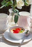 Creme brulee with fresh strawberry and green mint  Royalty Free Stock Photo