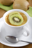 Creme brulee with kiwi in a cup Royalty Free Stock Photos