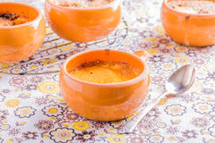 Creme brulee in a naive style. On a colored background Royalty Free Stock Photography