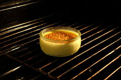 Creme brulee in the oven Stock Image
