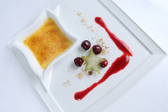 Creme Brulee - plate of fine dessert. Image of creme brulee on white plate royalty free stock photo