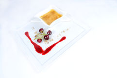Creme Brulee - plate of fine dessert. Image of creme brulee on white plate royalty free stock image