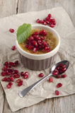Creme brulee with pomegranate seed Royalty Free Stock Photos