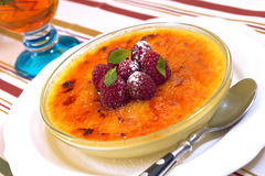 Creme brulee with raspberries Stock Photos