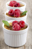 Creme brulee with raspberries and mint Stock Photo