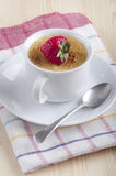 Creme brulee with strawberry in a cup Stock Image