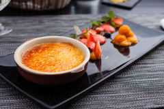 Creme brulee with strawberry Stock Image