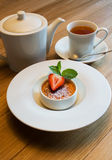 Creme brulee with strawberry Stock Photography