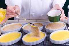 Creme Brulee Sugar Spreading Stock Images