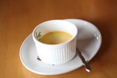 Creme brulee. Traditional French vanilla cream dessert with fruit royalty free stock photo