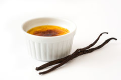Creme brulee and vanilla pods. Isolated on white background Royalty Free Stock Photo