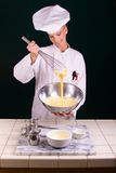Creme Brulee Whisking. Creme Brulee being whisked by a uniformed female Pastry Chef Royalty Free Stock Photos