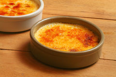 Creme brulee on wooden board Stock Images