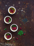 Creme brulees with raspberries and mint in white Royalty Free Stock Image