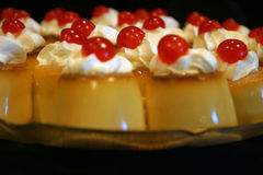 Creme Brulle. Creme caramel topped with cream and cherries Stock Photo