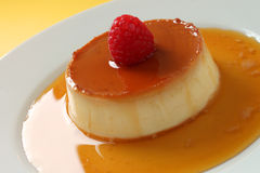 Creme Caramel. A closeup of a creme caramel dessert with a yellow background Royalty Free Stock Image