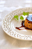 Creme caramel. On white plate known also as creme brulee Stock Photo