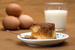 Creme caramel, caramel custard or custard pudding. With ingredients on background Royalty Free Stock Image