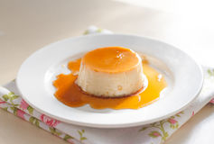 Creme caramel. Dessert creme caramel in a dish pour the caramel royalty free stock image