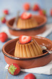 Creme caramel desserts & strawberries Royalty Free Stock Photo