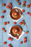 Creme caramel desserts & strawberries Stock Photography