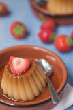 Creme caramel desserts & strawberries Stock Photo