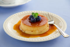 Creme caramel. With fresh blueberries stock image