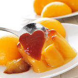 Creme caramel and peach in syrup Stock Images