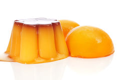 Creme caramel and peach in syrup Royalty Free Stock Photos