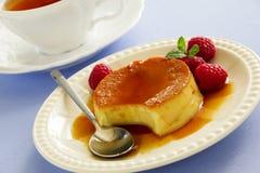 Creme caramel with raspberries Stock Photo