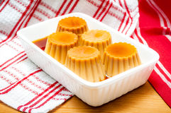 Creme caramel served with sweet syrup Royalty Free Stock Images