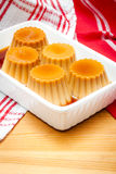 Creme caramel served with sweet syrup Stock Photo