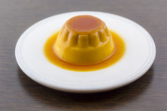 Creme caramel vanilla custard dessert or flan on white dish Royalty Free Stock Images