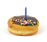 Creme filled donut with birthday candle on top Royalty Free Stock Photo