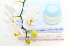 Creme and towels Royalty Free Stock Images
