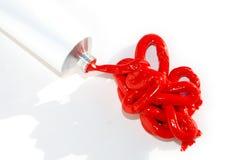 Creme vermelho derramado Fotos de Stock Royalty Free