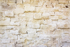 Cremefarbene Backsteinmauer Lizenzfreie Stockfotografie