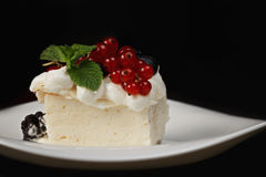 Cremeschnitte with berries in darkness closeup Stock Image