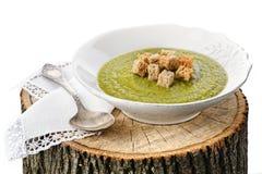 Cremesuppe der grünen Erbse mit Toast Lizenzfreie Stockbilder