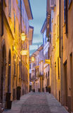 CREMONA, ITALY - MAY 24, 2016: The street of old town in morning dusk Royalty Free Stock Photos