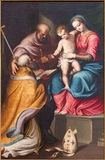 CREMONA, ITALY, 2016: The painting of Holy Family with the st. Nicholas in church Chiesa di Santa Agata by Bernardino Campi Royalty Free Stock Photography