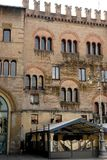 Crenellated facade of an old building in the center of Parma in Italy Stock Image