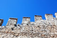 Crenellated wall of the old fortress Royalty Free Stock Image