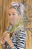 Creole African woman portrait Palm leaves in front of face stock photos