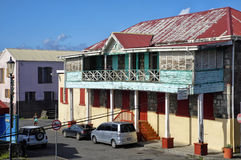 A creole style tenement house in Roseau city on January 9, 2017. Roseau is the capital of Dominica island, Lesser Antilles. ROSEAU, DOMINICA - JANUARY 9, 2017 stock photography