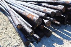 Creosote treated poles stock photo