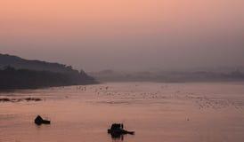Crepúsculo do rio de Khong em Chaingkhan Imagens de Stock